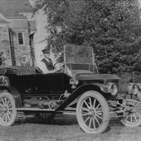 Clarence Marshall in new 1912 Stanley Model 74 at Auburn Heights.jpg